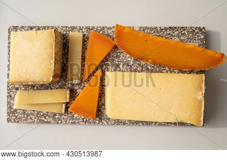 Cheese Collection, Hard French Cheese Old Cantal And Yellow Mimolette Made From Raw Cow Milk With Ri