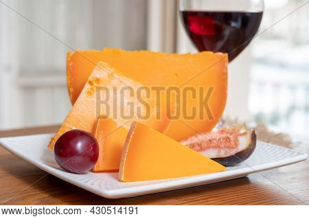 Cheese Collection, French Cheese Mimolette Made From Cow Milk Served With Fresh Figs And Red Wine