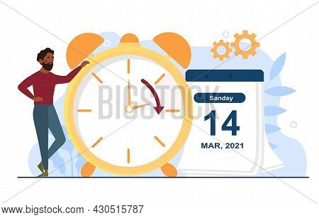 Change Your Clocks Concept. Man Switches Table Clock To Daylight Saving Time. Clocks Moves Forward O