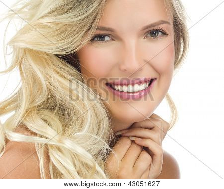 portrait of attractive  caucasian smiling woman blond isolated on white studio shot  lips toothy smile face long hair head and shoulders looking at camera
