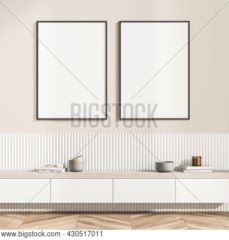 Two White Posters On The Beige Wall Of The Living Room Interior With A Hanging Sideboard And A White