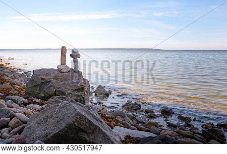 Stones Balance, Zen Pebbles Stack Over Blue Sea In Estonia. Blue Sky On Sunny Coast In Summer. Relax