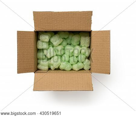 Packaging Foam Filler In The Cardboard Parcel Box Isolated On A White Background. Open Brown Box  Fi