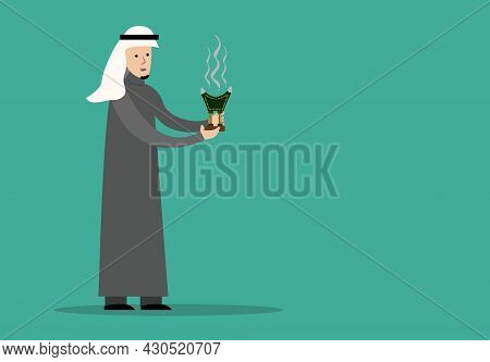 An Arab Man Holds  A Traditional Incense Burner Called Makhbara Which Is Still Used In The Arab Worl