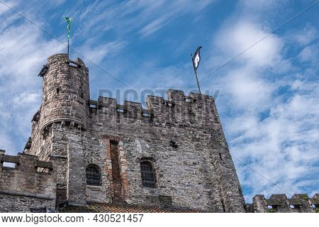 Gent, Flanders, Belgium - July 30, 2021: Gray Stone Highest Tower On Top Of Central Building Of Grav