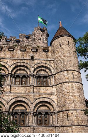 Gent, Flanders, Belgium - July 30, 2021: North-east Corner Of Gray-brown Wall And Towers Of Medieval
