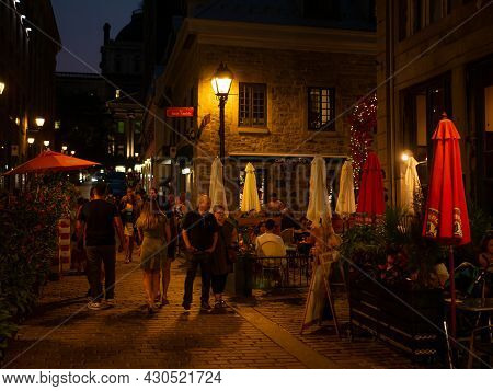Montreal, Canada. August 2021. People Walking In The Old Port Of Montreal And Bonsecours Market At D