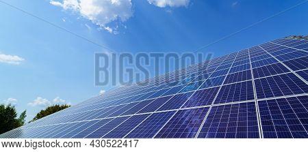 Solar Panels On The Sky Background. Solar Power Plant. Blue Solar Panels. Alternative Source Of Elec