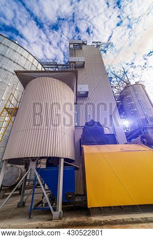Huge Metal Industrial Containers. Storage Construction Silo Tanks.