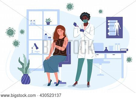 Nurse  In A Mask And Gloves In A Clinic Makes A Young Girl A Coronavirus Vaccine. Vaccination And Im