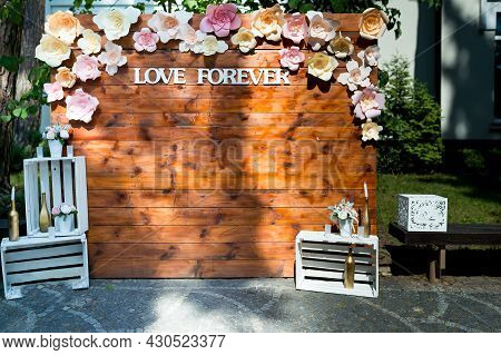 Wedding Flowers And Wooden Decoration. Vintage Style Of Marriage Decoration. Wedding Concept