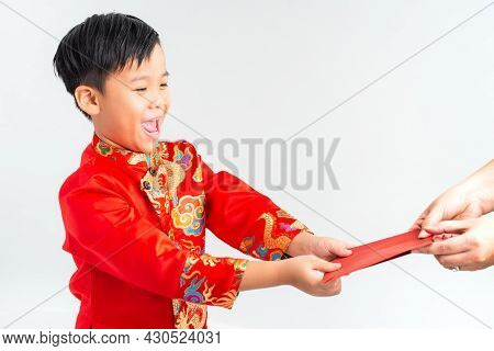 Asian Vietnamese Boy Receiving Red Paper Packet Or Monetary From Another On Lunar New Year Festival,