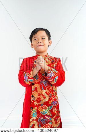 Cute Little Vietnamese Boy In Ao Dai Dress Smiling. Tet Holiday