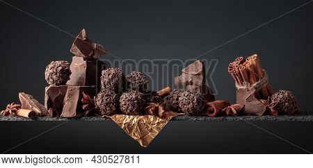 Chocolate Truffles With Broken Pieces Of Chocolate And Spices. Chocolate, Cinnamon Sticks And Anise