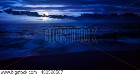 Calm Sea Scenery At Night. Waves Wash Empty Sandy Beach In Full Moon Light. Relax And Summer Vacatio