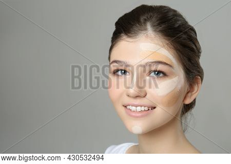 Beautiful Girl On Grey Background. Using Concealers And Foundation For Face Contouring