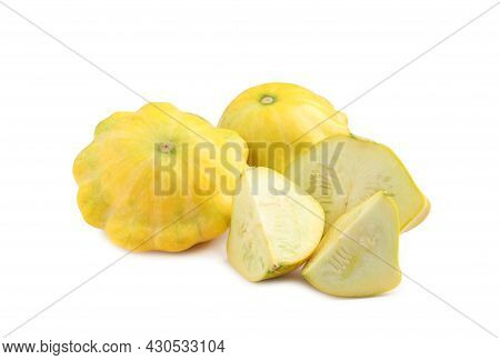 Whole And Cut Pattypan Squashes On White Background