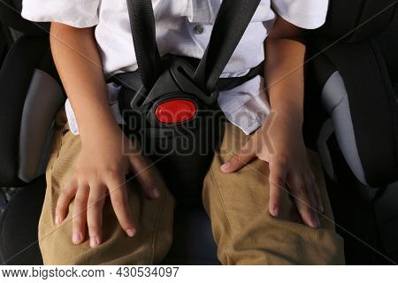 Little Boy Fastened With Car Safety Belt In Child Seat, Closeup