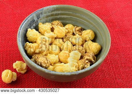 Taiwanese Bubble Tea Caramel Popcorn In Bowl On Red Background