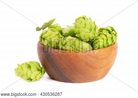 Fresh Green Hops Branch In Wooden Bowl, Isolated On A White Background. Hop Cones With Leaf. Organic