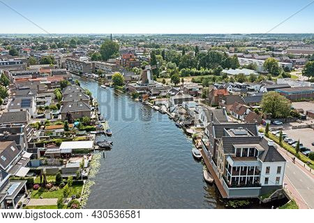 Aerial from the city Bodegraven in the Netherlands at the river The Oude Rijn