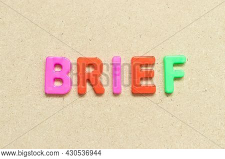 Color Alphabet Letter With Word Brief On Wood Background