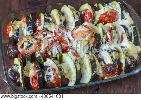 Ratatouille.traditional Provencal Stew Of Seasonal Vegetables On A Wooden Background.close-up