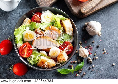 Classic Caesar Salad With Chicken Fillet And Parmesan Cheese. Chicken Caesar Salad. Top View, Copy S