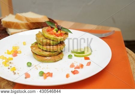 Vegetable fritters of zucchini served on a plate