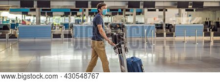 Banner, Long Format Man In Mask At Empty Airport At Check In In Coronavirus Quarantine Isolation, Re