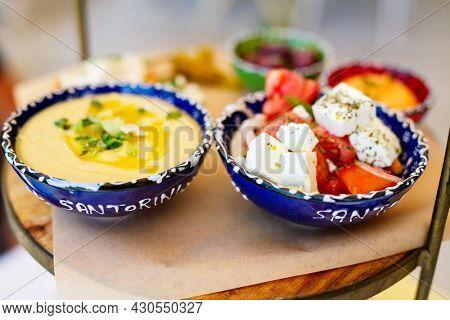 Selection of traditional greek meze: fava, greek salad and olives