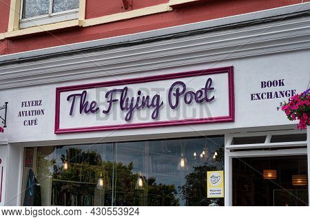 Kinsale, Ireland- July 13, 2021: The Sign For The Flying Poet Shop In Kinsale