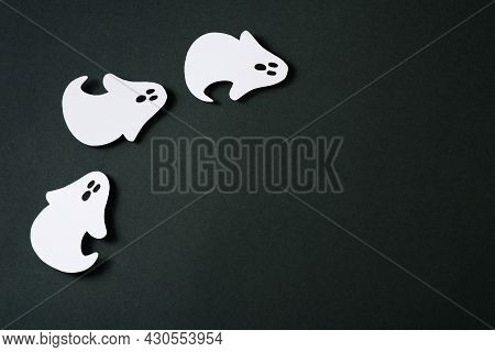 Handmade Kids Craft Paper Ghost Halloween Party On Black Background, Copy Space, Top View, Flat Lay