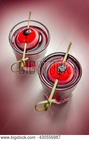 Scary Drinks Shots Made With Tequila, Grenadine And Tabasco Decorated With Jelly Eyeball