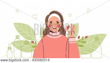 Woman Takes Care Of Her Face. She Is Holding A Strawberry In Her Hands. Collection Of Body And Skin