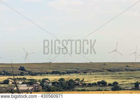 Landscape With A View Of Wind Turbines In The Steppe For Industrial Power Generation
