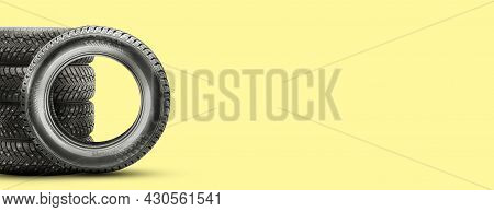 Winter Studded Tires, Isolate On A Yellow Background Copy Space. Auto Parts And Tire Changes