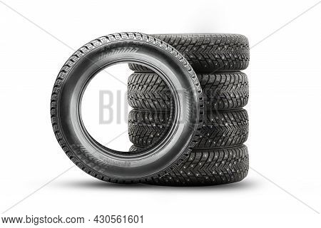 Winter Directional Studded Tires Isolate, Set Stack On A White Background 4 Wheels, Safety On Ice