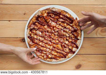 Pizza Dining. Two Hands Taking Pizza Slices, On Top Of Wooden Table, Overhead Shot. Two Hands Taking