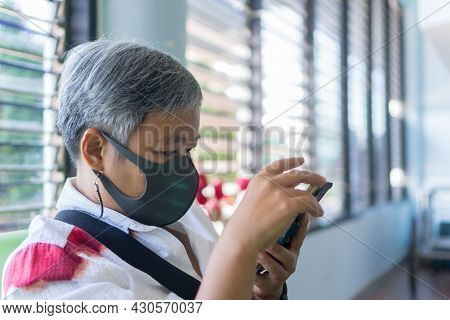 New Normal For Daily Life. Patient Older Asian Covid-19 Protection Situation In Facemask In Travelin