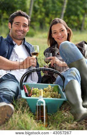 Grapepickers enjoying a glass of wine