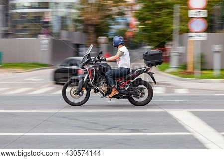 Motorcycle Honda Crf1100l With Dual-clutch Transmission In Motion On The City Highway. Side View Of