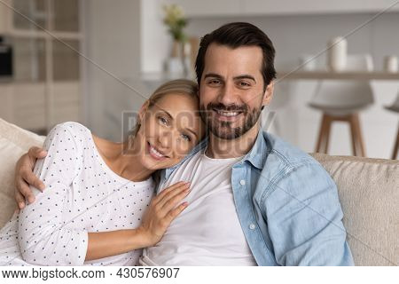 Happy Millennial Married Couple Of Homeowners Head Shot Portrait
