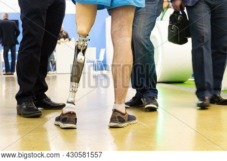 A Man With A Modern Prosthetic Leg In The Building Of A Rehabilitation Center. Trying And Learning T