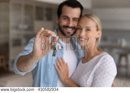 Happy Millennial Couple Showing Key From New House