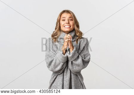 Young Attractive Girl Begging For Help, Clenching Hands Together And Pleased, Saying Please, Standin