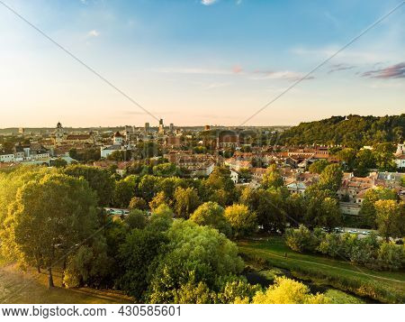 Beautiful Vilnius City Panorama In Autumn With Orange And Yellow Foliage. Aerial Evening View.
