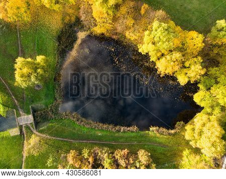 Beautiful Vilnius City Top Down View In Autumn With Orange And Yellow Foliage. Aerial Evening View.