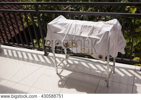A Washed Curtain Hanging On A Dryer Rack Under Sun