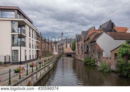 Gent, Flanders, Belgium - July 30, 2021: Sint Antoniuskaai Along Lieve River Looking At Augustinian